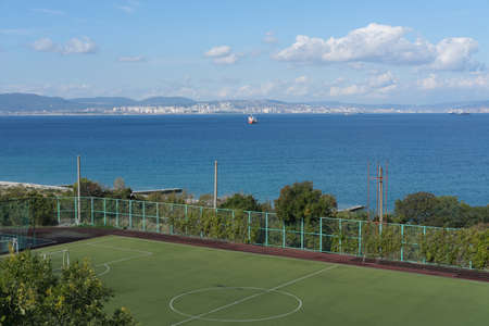 Empy stadium on a high hill over the sea. Stock fotó