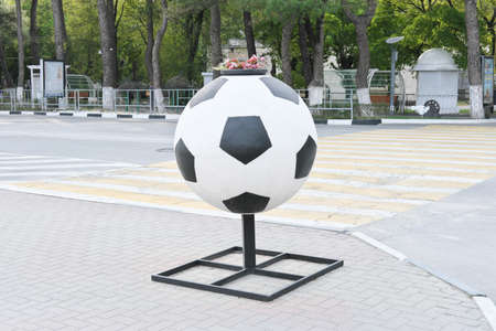 street vase in shape of giant football or soccer ball classic colors, sport and footbal playing concept. world championship. Stock fotó