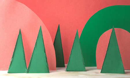 paper cut art christmas decor. DIY paper christmas trees. display for product presentation. hand made trees and landscape