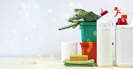 Christmas cleaning. Cleaning tools and Christmas decorations. copy space. housekeeping before holidays, bokeh lights, bottles of detergents and sprays. rug and sponge. Stock fotó
