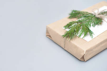 craft paper wrapped gift, reusable sustainable recycled gift wrapping alternative zero waste concept.