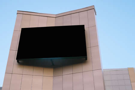 giant outdoor screen for advertising and commercials. big empty black digital billboard screen on the building, mock up for your design. streeet commercials. Stock fotó