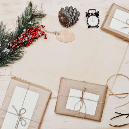 Zero waste Christmas flat lay. stylish simple christmas gifts in craft paper on rustic white table with fir branch, and pine cone. Plastic free sustainable lifestyle. Stock fotó