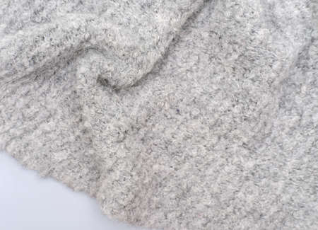 cozy gray knitted textured scarf. top view of a baktus winter scarf. winter outfit. trendy acsessories for women