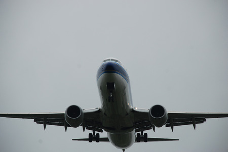 Airplane on the runway strip on the rainy day