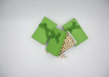 Golden pearls in the green gift box