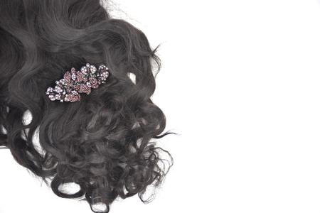 Dark brown curly hair with hair