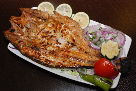 fresh fish on the white plate