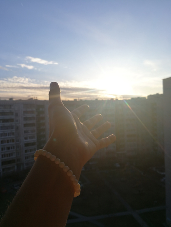 The sunset and hand