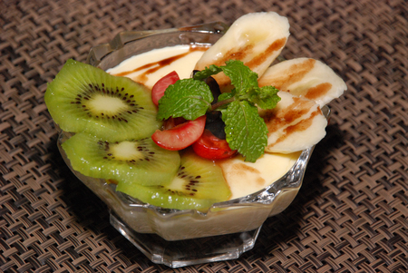 milky desert with kiwi, cherry, banana, mint and chocolate toping