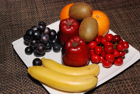 Fresh Oranges, apples, grapes, kiwis, cherries, bananas