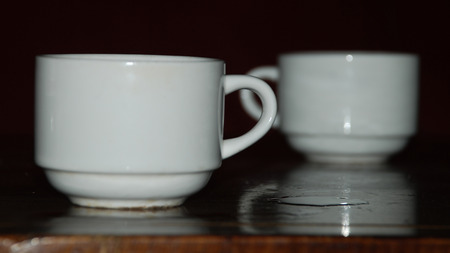 One cup away from another with some perspective of space Imagens