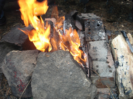 camping time with fire, surrounded with bricks and stones