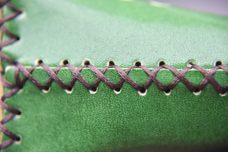 handmade leather stiching line Imagens