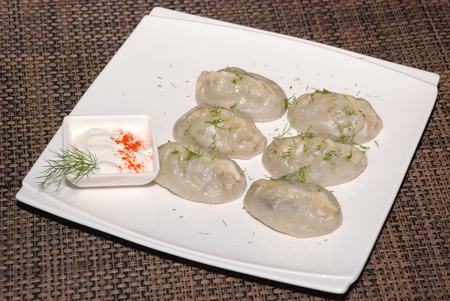 big dumplings with sour cream and dill