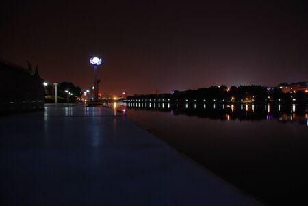 Night city with orange lights at summertime Фото со стока