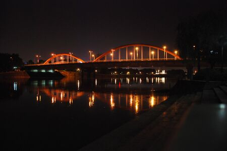 Night city with orange lights at summertime Banco de Imagens