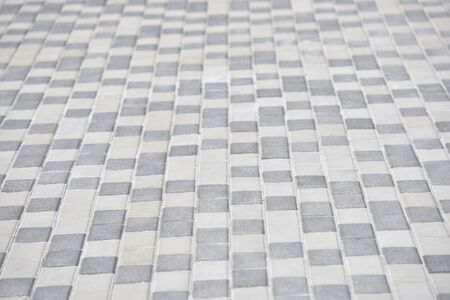 the road made of white and grey tiles
