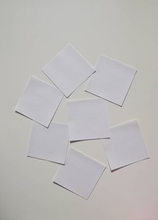 small white papers on the white board
