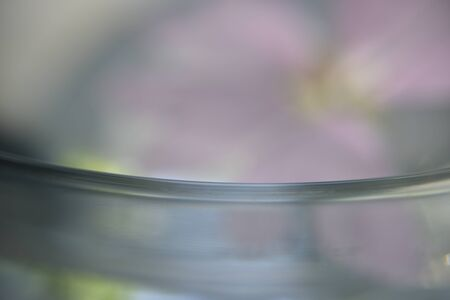closer look at polished glass edge with pink flower on the back