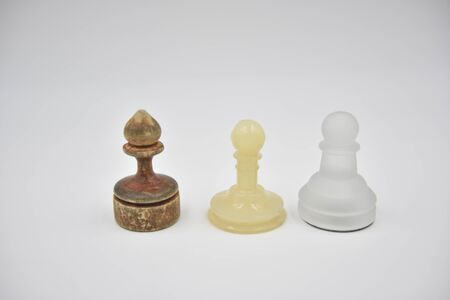 wooden, glass and plastic ponces on white background