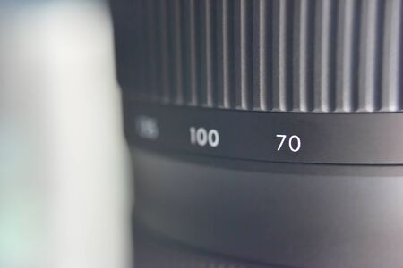 selective focus on scale of distance between camera sensor and point of convergence on the black lense