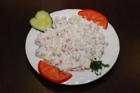 vegeterian version of russian salad served on the white dish