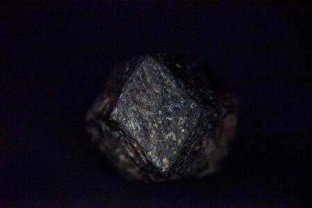 garnet stone hidden in rough form with metal ore Фото со стока