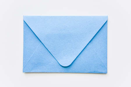 classic blue  closed envelope with round corners on the white background Фото со стока