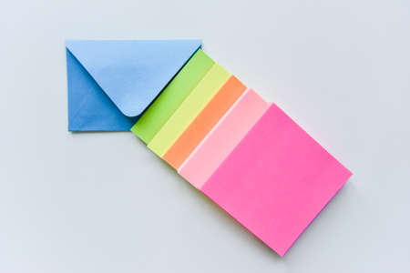 selective focus, blue envelope in the center with bright colored rectangles directed towards the corner