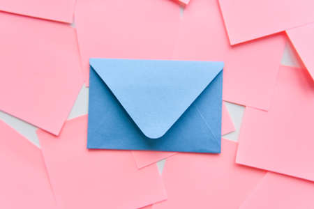 selective focus, classic blue envelope on the background of coral stickers