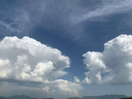 white clouds in the sky right before the storm over the swat valley in Pakistan Фото со стока