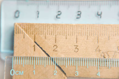plastic and wooden rulers fragments, selective focus