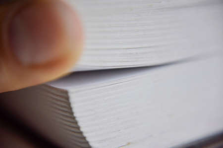 selective focus, macro look at the pages of the thick book, knowledge concept Фото со стока