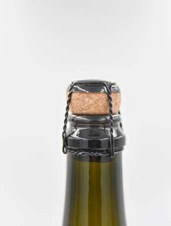 closer focus at the top part of the wine bottle with the long neck