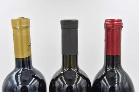 tselective focus at the central of three wine bottles. only top parts of the bottles