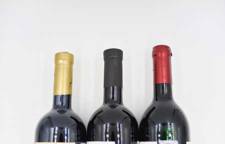 the top part of three wine bottle with the long neck