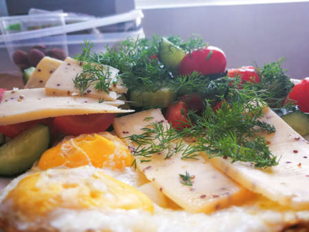 selective focus at the fresh breakfast with cheese and vegetables