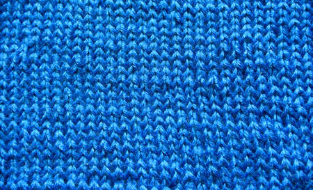 blue knitted fabric under the bright light. texture concept