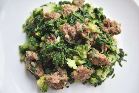 selective focus at the minced meat with spinach and broccoli Фото со стока