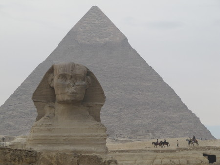 Sphinx in front of Pyramid in Egypt. Giza pyramid complex.