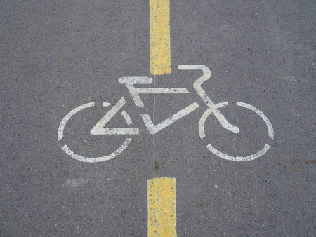 sign Bicycle paths on the gray asphalt on a city street. 스톡 콘텐츠