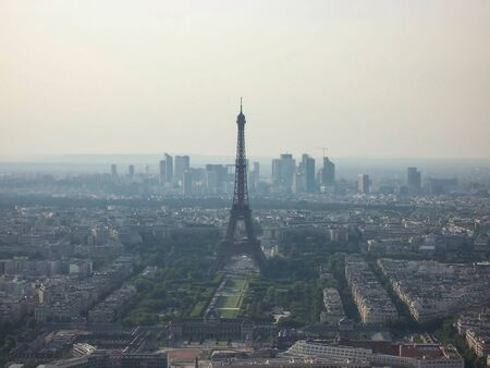 fog smog over Paris. extraordinary aerial view of the Eiffel tower. Stock Photo
