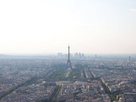Aerial view of the central part of Paris at the cloudy day with light haze in the air.
