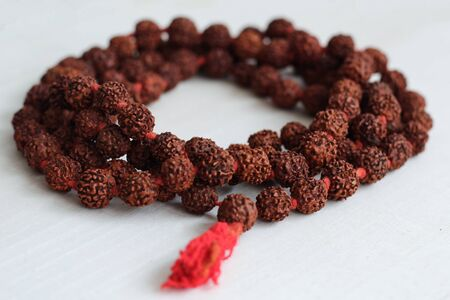 Japa mala on the table. Prayer beads made from the seeds of the rudraksha tree.