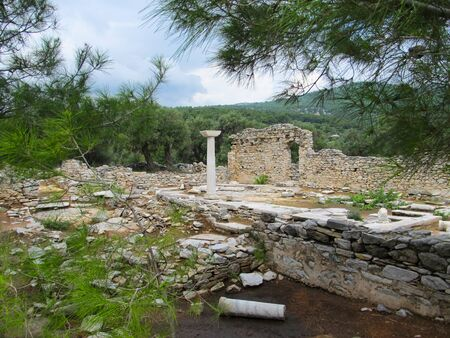 Columns in ancient church in Archaeological site of Aliki, Thassos. Reklamní fotografie