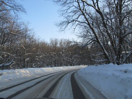 view of the snow-covered track from the windshield of the car.
