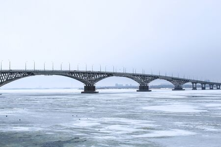 Bridge across the Volga river between the cities of Saratov and Engels. Ice on the river. Russia.