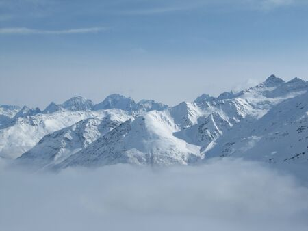 Mountain range above layer of white clouds. beautiful scenery.