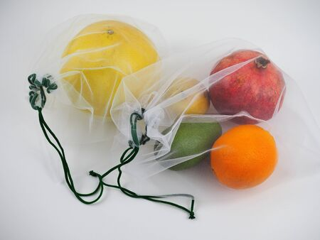 colorful fruits in an eco bag. the concept of zero waste. Stock Photo
